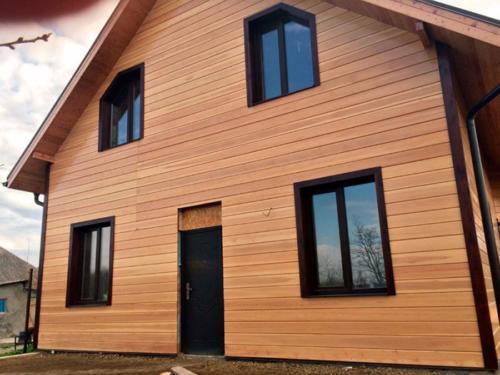 Фасад дома имитация бруса лиственница